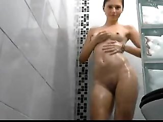 Horny And Busty Masturbate with the Shower