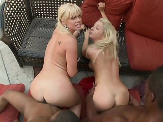2 platinum-blonde honeys with enormous lips comply blacks stiffys outdoors