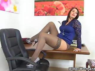 Dark haired, Brit cougar is fuckin' her cunt with a ebony magic wand, in her office