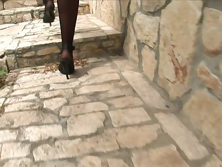 Lengthy haired dark haired gets pummeled in stilettos and nylons in a basement
