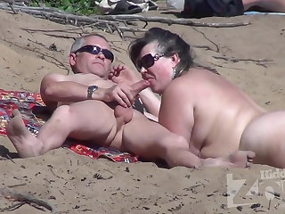 Blowjob heavens a nudist beach.