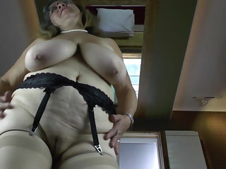 Old granny with broad in the beam saggy tits and hungry cunt